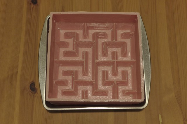 Greased Hilbert curve cake mold