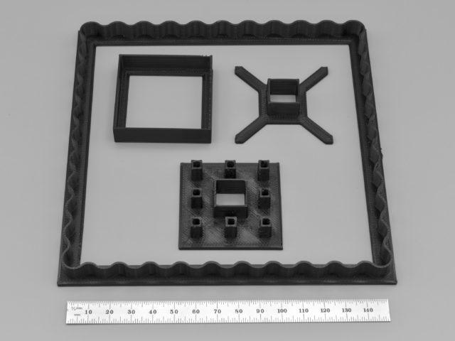 Photo of cookie cutters for a Sierpiński carpet Linzer