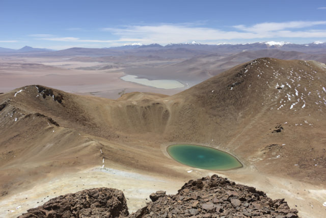 Green crater lake viewed from Cerro Zapaleri summit